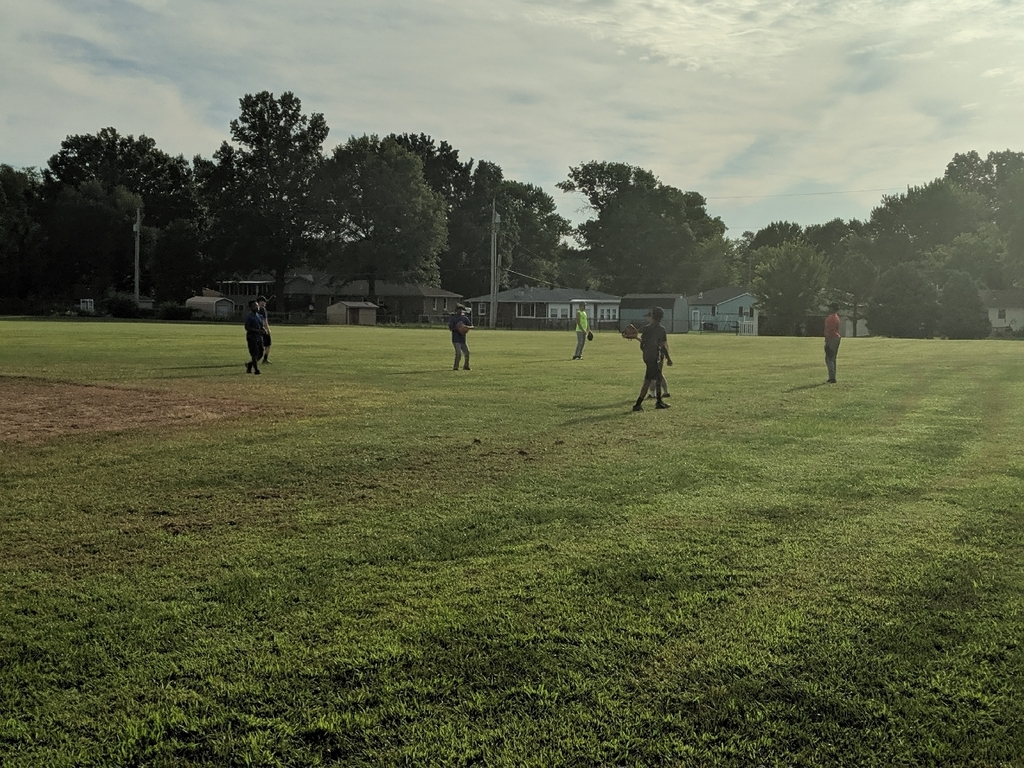 Baseball players warming up for another fun day of drills, skills, and practice.