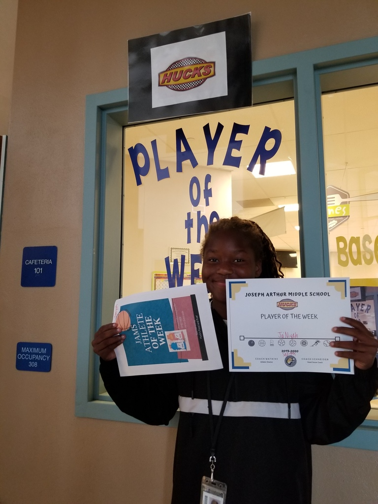 Athlete holding certificate