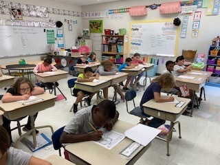 Students writing Pen Pal Letters