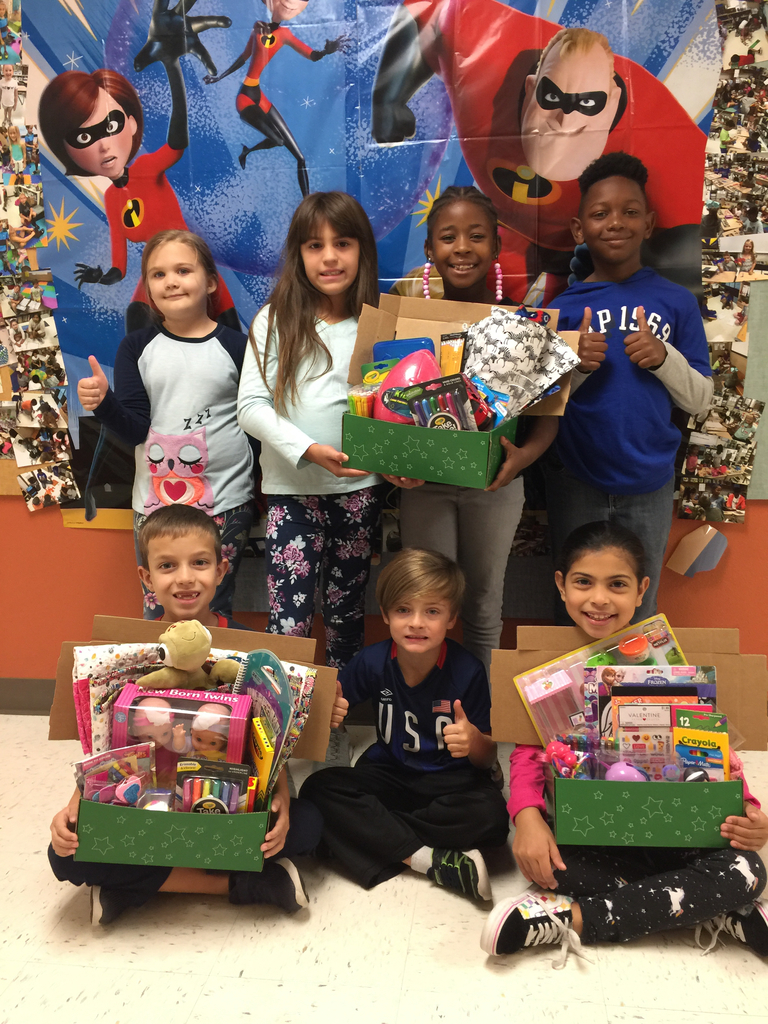 2nd graders holding Operation Christmas Child Boxes
