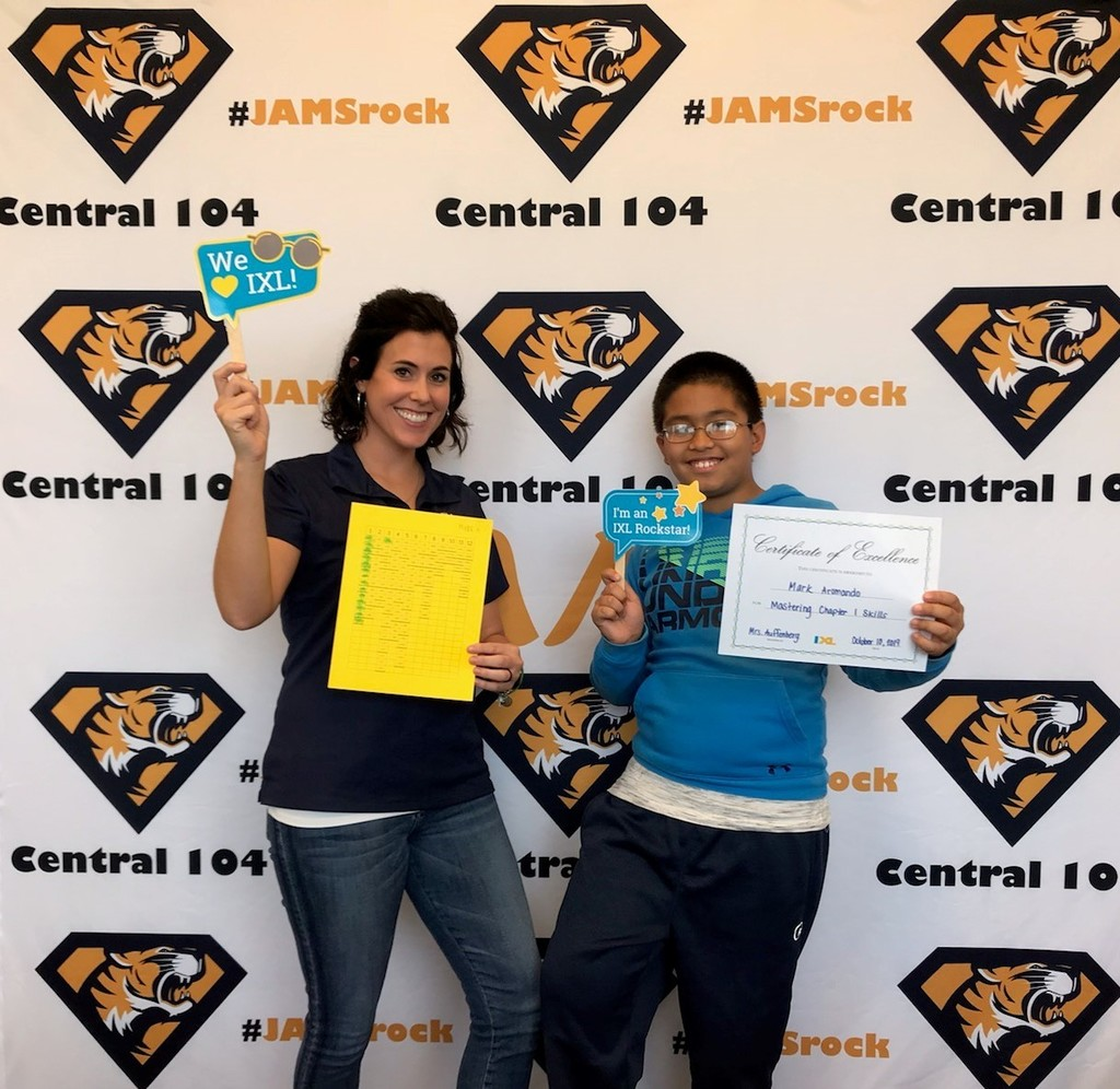 Mrs Auffenberg with a student posing with certifcate